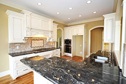 Black Granite kitchen white cabinets - Mesa Mesa